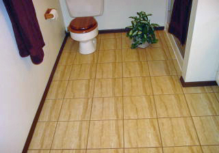 How to Lay a Floating Porcelain or Ceramic Tile Floor Over a ...