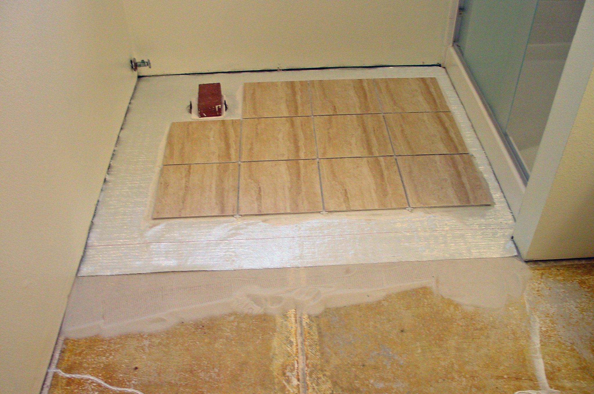 How to lay a floating porcelain or ceramic tile floor over a sand fiberglass mat and tile over cracked concrete slab dailygadgetfo Choice Image