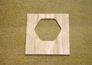 Tile with hexagon cutout.