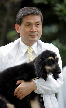 Professor , Dr. Woo-Suk Hwang with Cloned Dog named Snuppy.